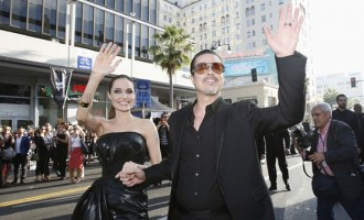 Crazy love! Overzealous fan lashes out at Brad Pitt on red carpet