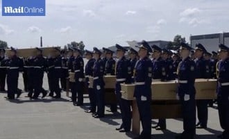 Dutch welcome home first remains of MH17 victims