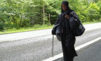 VIDEO: The mysterious woman in black walking across the US