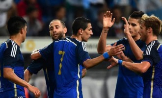 Di Maria inspires Argentina's rout of world champions