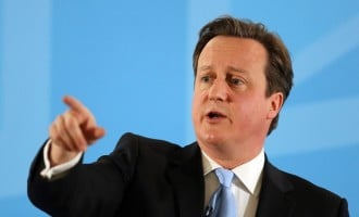 Man shoves British PM Cameron