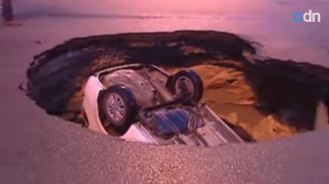 Sinkhole swallows car in China