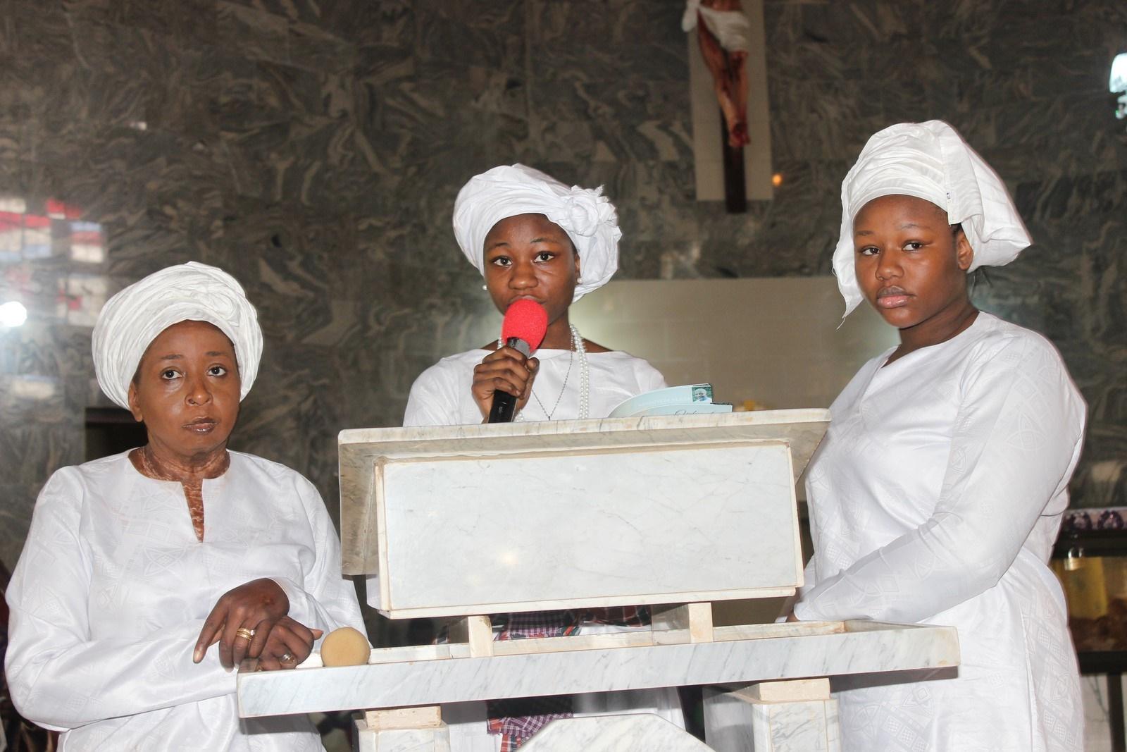 Bereaved daughter rendering tributes