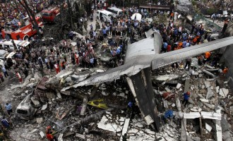 '140 killed' as Indonesian plane crashes into residential area