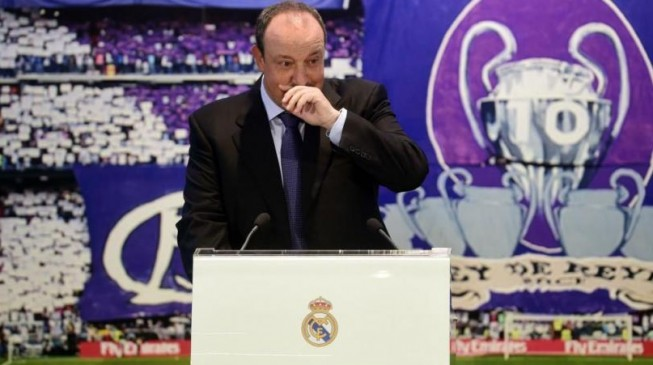 Emotional Benitez takes charge of Real