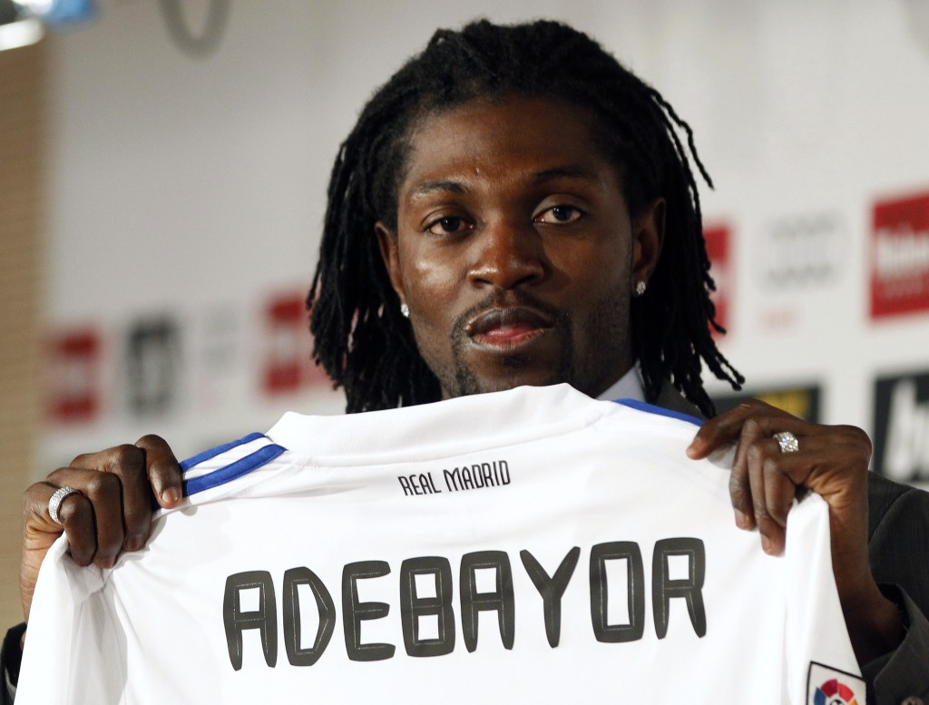 Emmanuel Adebayor holds up his new Real Madrid jersey during a presentation at the Bernabeu stadium in Madrid