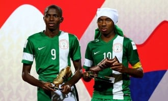 5 youth players flying the Nigerian flag proudly