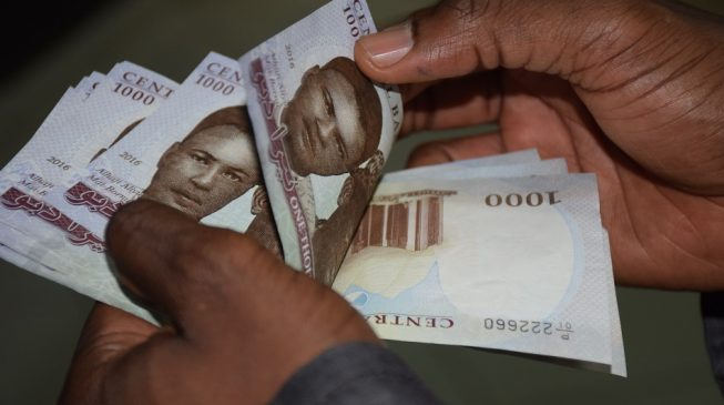 Naira buoyed by trade optimism and rebounding oil prices