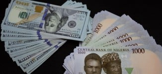 Naira regains strength, trades at N370/$
