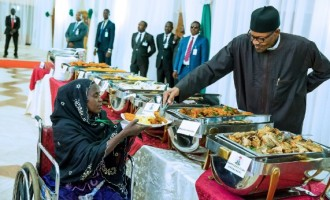 EXTRA: Buhari ends Ramadan by personally serving food to IDPs, hairdressers, tailors