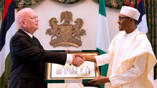 Buhari urges departing Entwistle to write a book on Nigeria