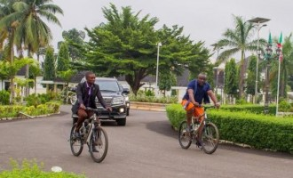 EXTRA: Okorocha abandons convoy, rides bicycle on streets of Owerri