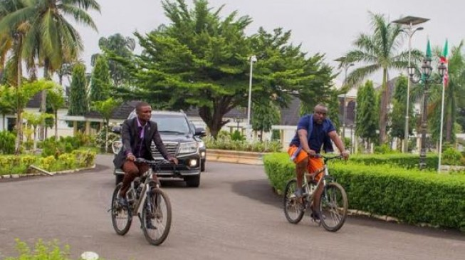 EXTRA: Okorocha abandons convoy, rides bicycle on streets of Owerri