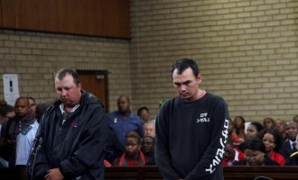 2 white South Africans arraigned for 'forcing' black man into a coffin