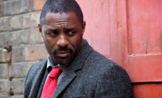 Idris Elba joins over 300 black artists calling on Hollywood to 'divest from police'
