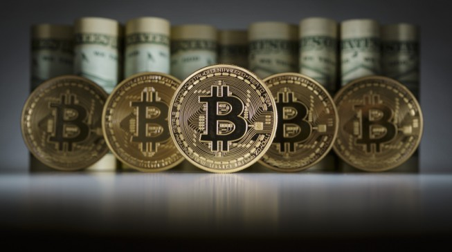 Global stocks under pressure; Bitcoin hits another record