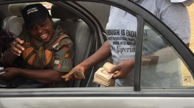 CAUGHT ON CAMERA: Anti-Amnesty protesters collecting money in Abuja