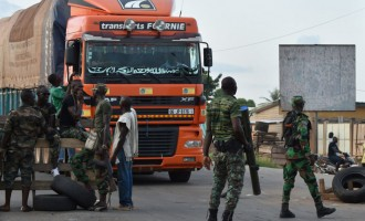 Heavy gunfire erupts in Ivory Coast's two main cities