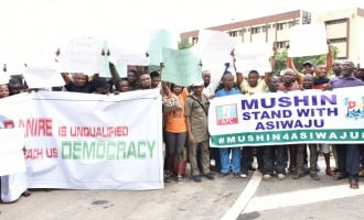 APC crisis: Protesters storm Ambode's office, demand expulsion of Banire