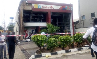 Mob sets banks ablaze as policeman 'kills' tanker driver (updated)