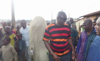 EXTRA: From pulpit to eid ground… Fayose goes traditional with masquerade