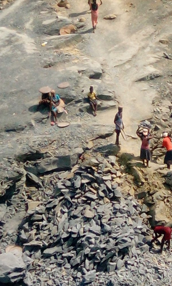 Children taking turns to fetch stones out of the pit