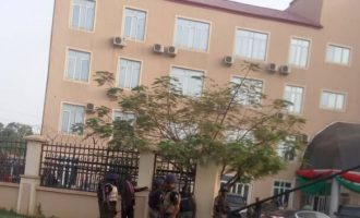 PHOTO: Armed policemen on guard at hospital treating Buhari's son
