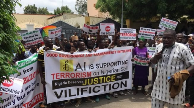 PHOTOS: Protesters storm Amnesty International's Abuja office 24 hours to launch of report on rape