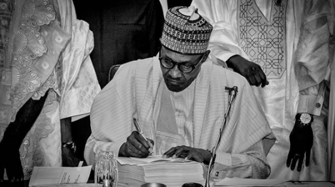 VIDEO: The moment Buhari signed 2018 budget into law