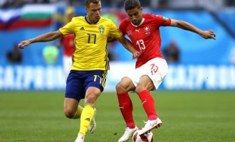 IN PICTURES: Actions from Sweden, Switzerland match