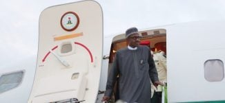 Buhari returns to Abuja after economic summits in Jordan, Dubai