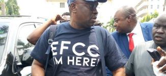 'I'm here' — Fayose storms EFCC office with his bag of clothes