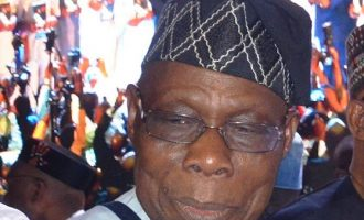 Garba Shehu: Obasanjo owes Nigerians explanation over his absence at Buhari's inauguration