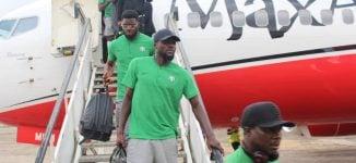 Super Eagles arrive Asaba after picking 2019 AFCON ticket