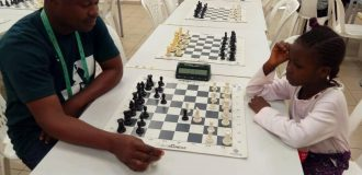 Six-year-old chess player chases gold at National Sports Festival