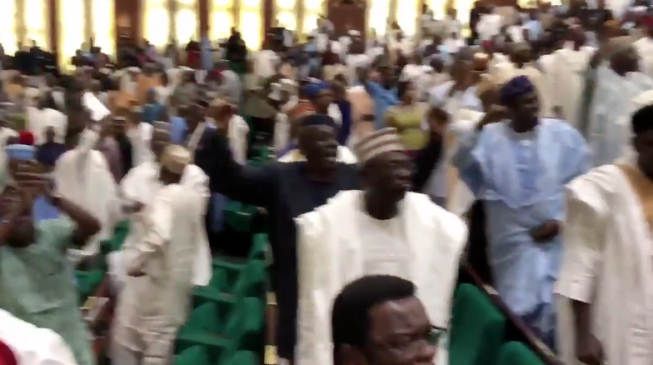 'The world is watching you' — Buhari tells booing lawmakers