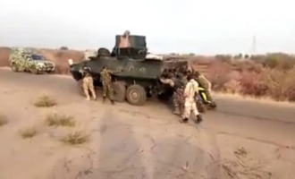 TRENDING VIDEO: Nigerian soldiers push armoured tank on battle field