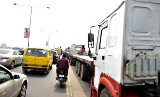 PHOTOS: Trucks back on Lagos bridges after Buhari's visit — and so is traffic