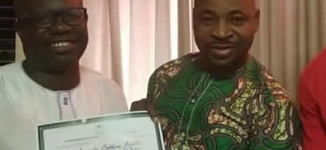 EXTRA: Rep-elect presents his certificate of return to MC Oluomo