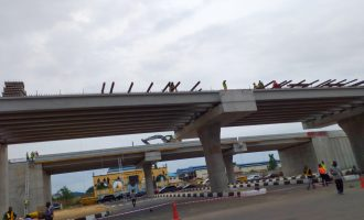 PHOTOS: Construction still going on at Lagos airport road — 48 hours after inauguration by Buhari