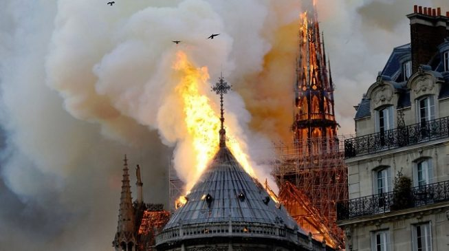 Roof collapses as fire rages '856-year-old' Notre Dame cathedral