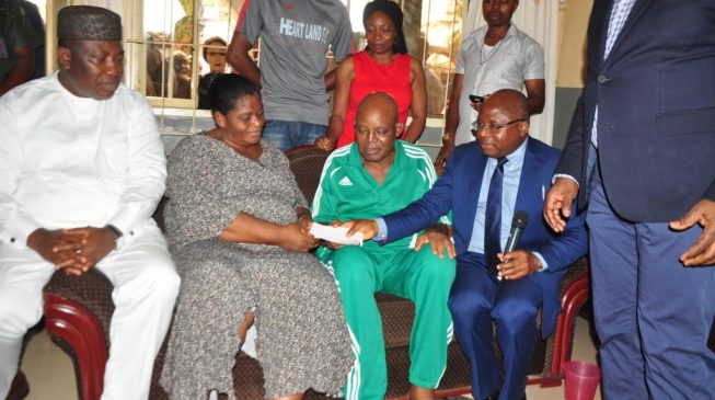 Otedola presents $50,000 cheque to Christian Chukwu for foreign medical treatment