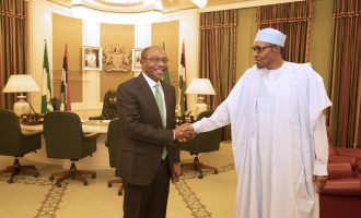 PHOTOS: Emefiele all smiles as Buhari congratulates him over his reappointment