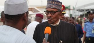 Journalism under threat, Buhari laments