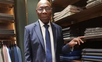 PHOTOS: Obasanjo steps out in suit
