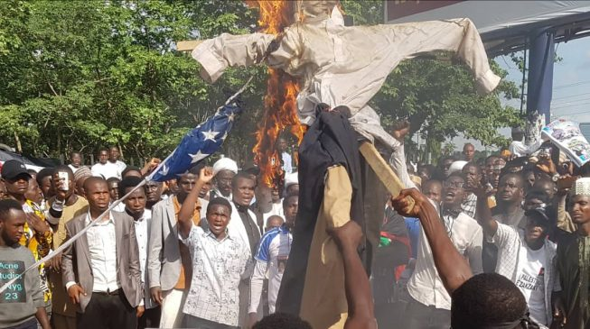 Shi'ites set US flag on fire in Abuja