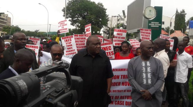 Senator-elect leads protesters to INEC headquarters over certificate of return