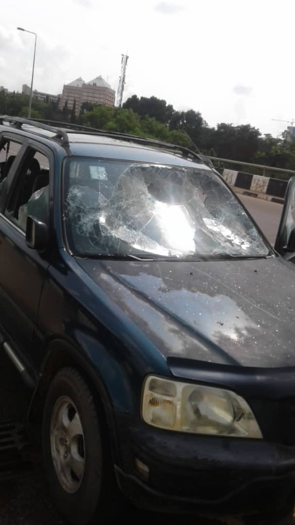 Shiites attack NASS4 - [PHOTOS] Shi'ites Storm National Assembly, Destroy Cars