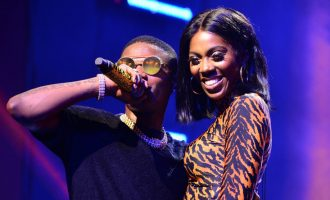 'He even grabbed her bum' — reactions as Wizkid, Tiwa Savage share kiss on stage