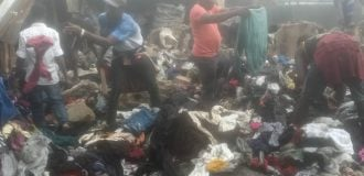 PHOTOS: Traders inspect wares after fire outbreak at Lagos market
